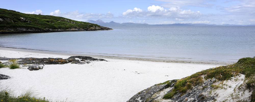 One of the numerous beaches on Gigha looking towards Jura