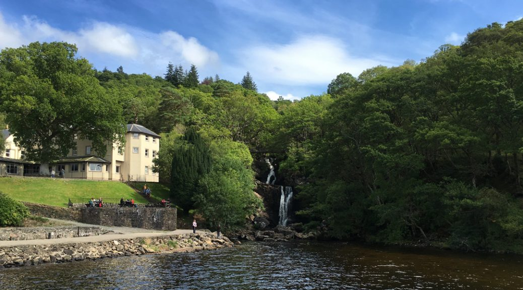 View from the loch of Invernaid Hotel with Arklet Falls to the right