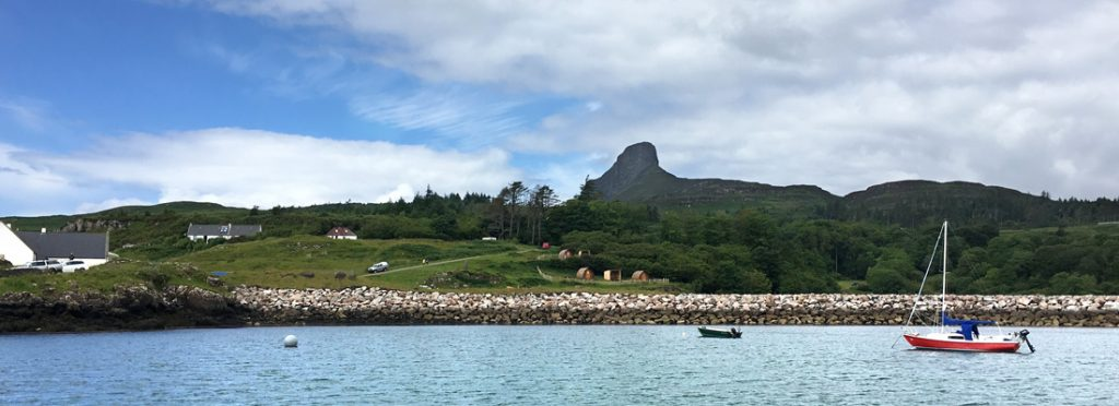 View of the Isle of Eigg from ferry arriving at Galmisdale