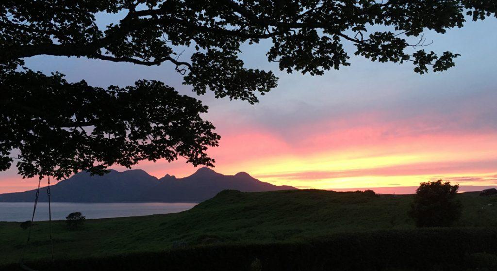 Sunset on the Isle of Eigg looking towards Rum