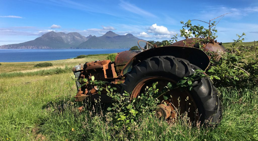 Old tractor on the Isle of Eigg with Rum in the distance