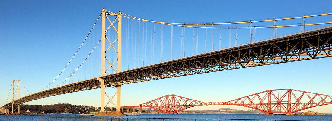 The old Forth Road Bridge over the river Forth with the Forth Railway Bridge in the background