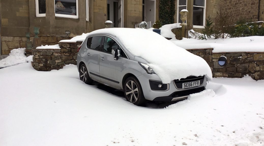 Our car covered in snow from the Beast from the East